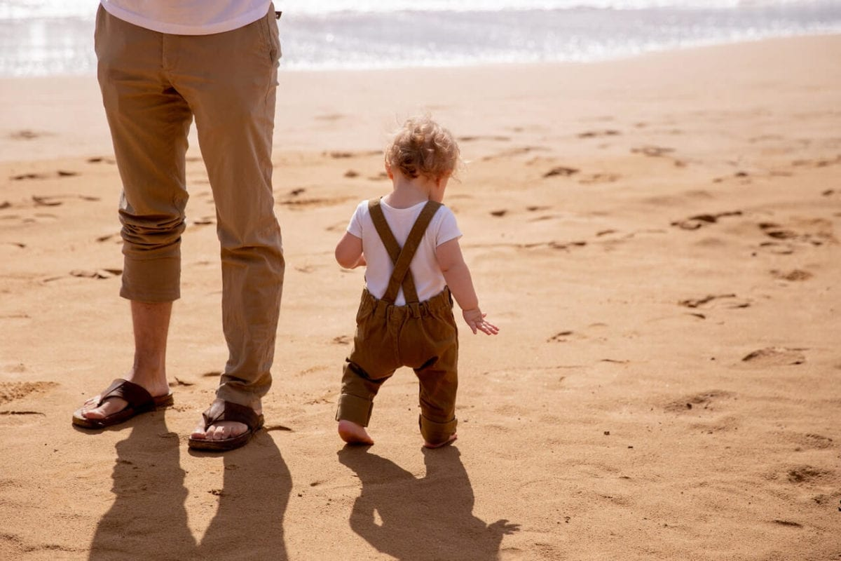 Father and child on beach wondering about presumption of paternity