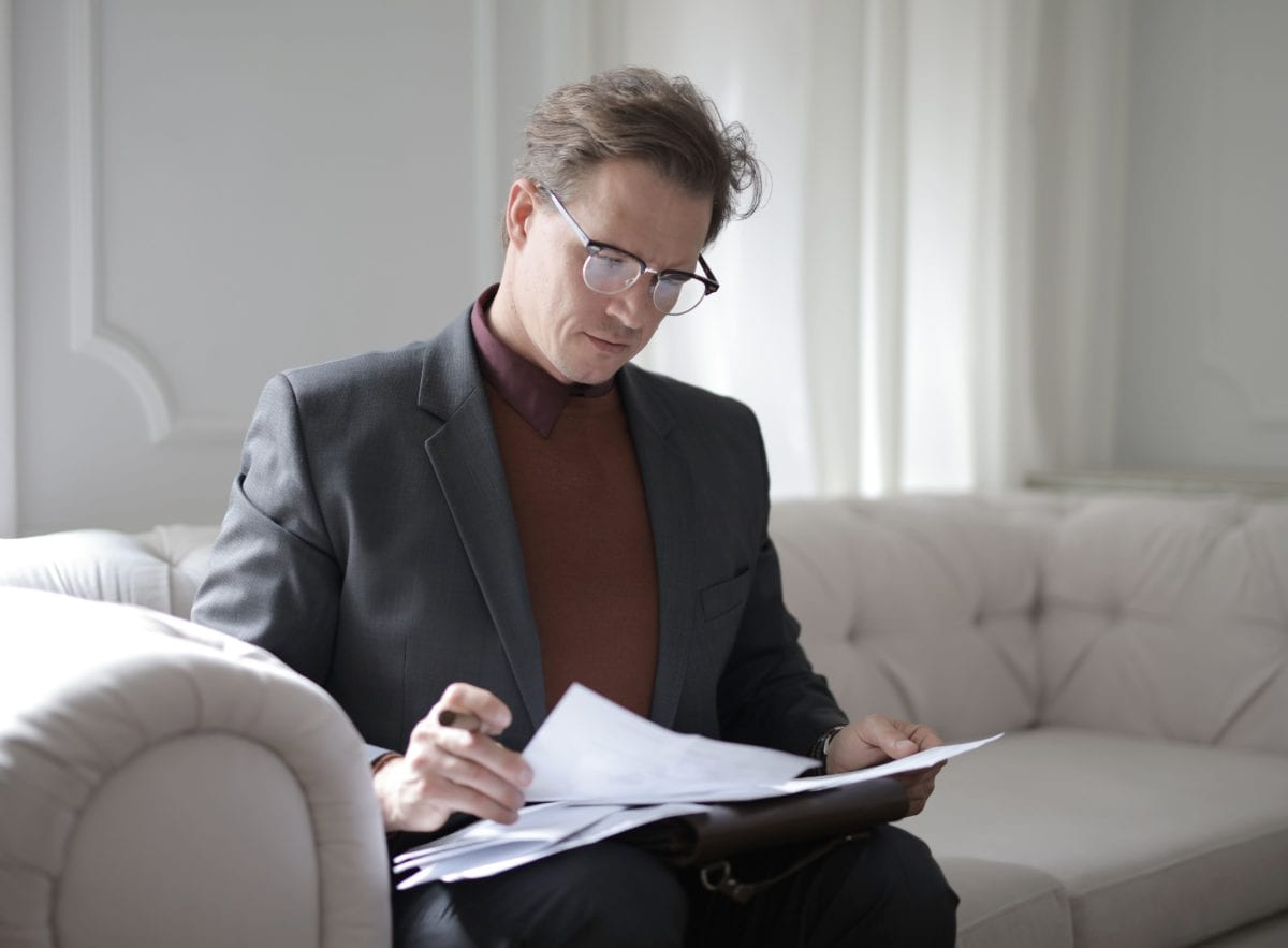Lawyer in a suit drawing up a legal document on best practice of how to split your assets when divorcing