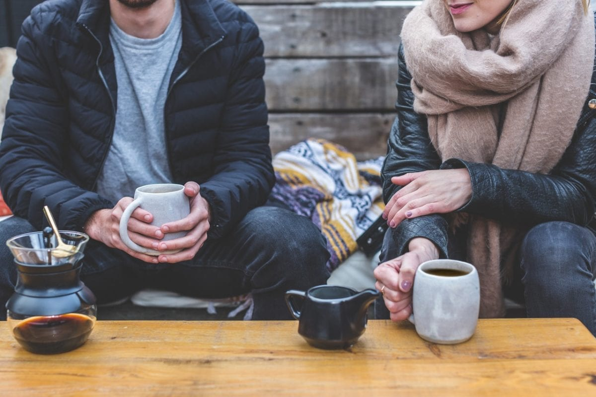 Couple having coffee and talking about divorce regrets