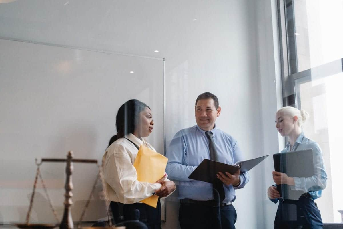 Group o f professional thinking about questions to ask a divorce lawyers